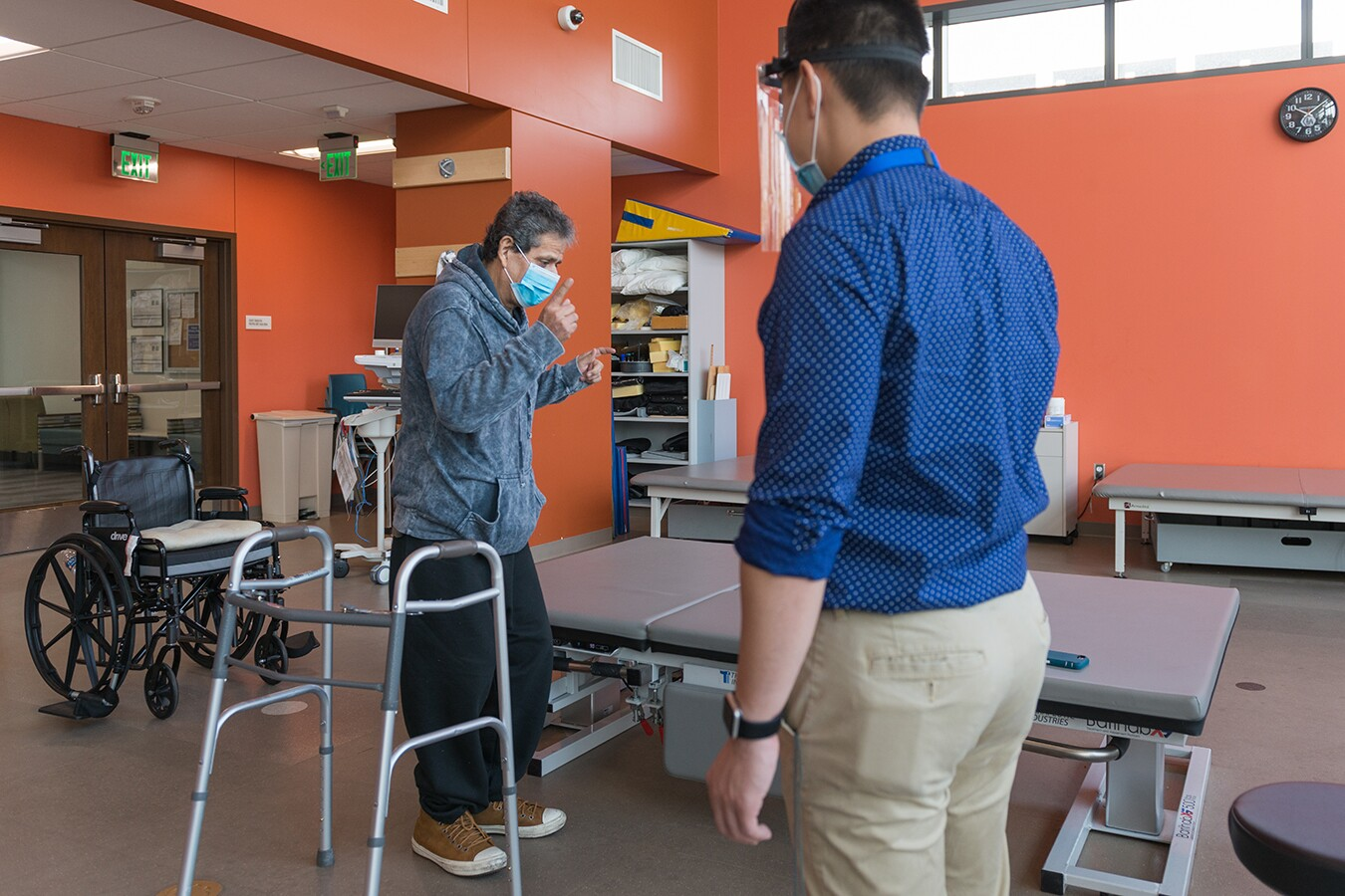 Perez dances to cumbia music as part of his physical therapy.