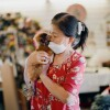 Jessica Pak holds one her chickens in her tailor shop.