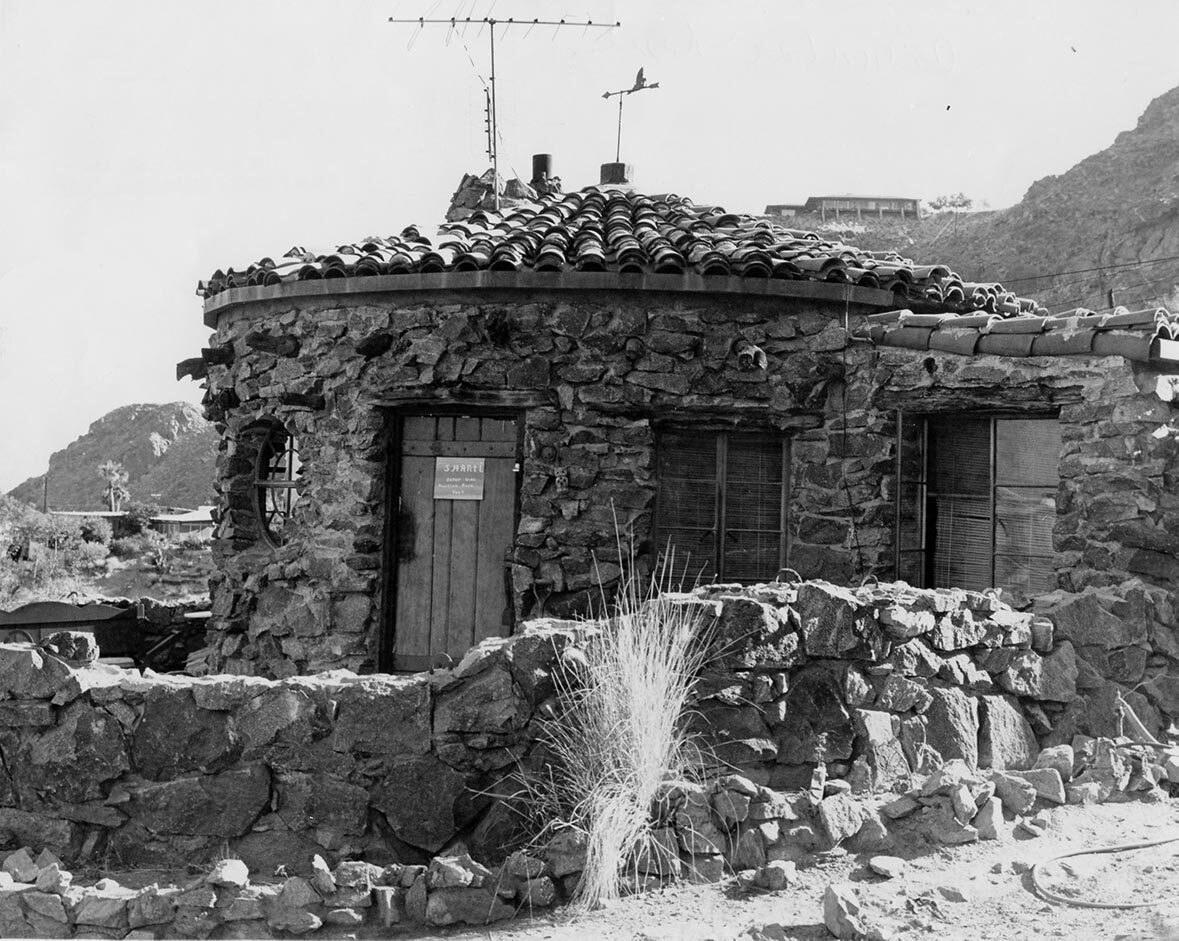 """The former home of architect R. Lee Miller. The sign on the door says: """"Shanti. Enter with Primitive Bare Feet."""" 