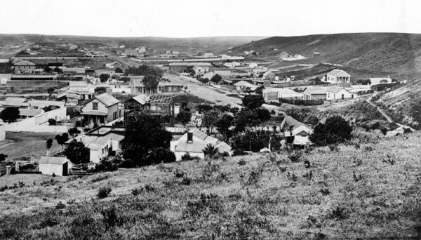 This 1869 view of Los Angeles, looking south from First and Broadway, shows an undeveloped Bunker Hill flanking the the growing city. Courtesy of the Title Insurance and Trust / C.C. Pierce Photography Collection, USC Libraries.
