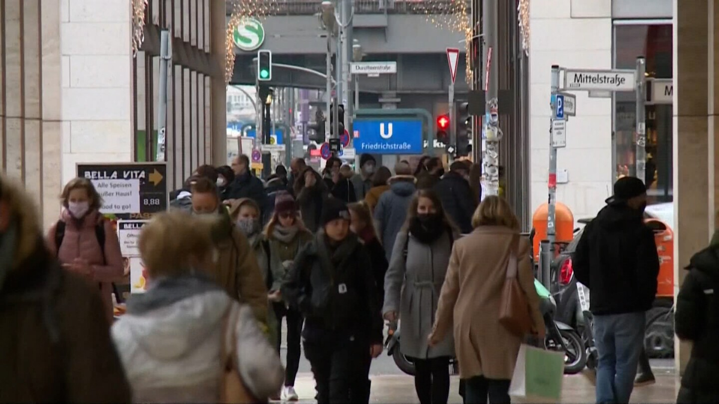 Many people walking through a street in Germany.