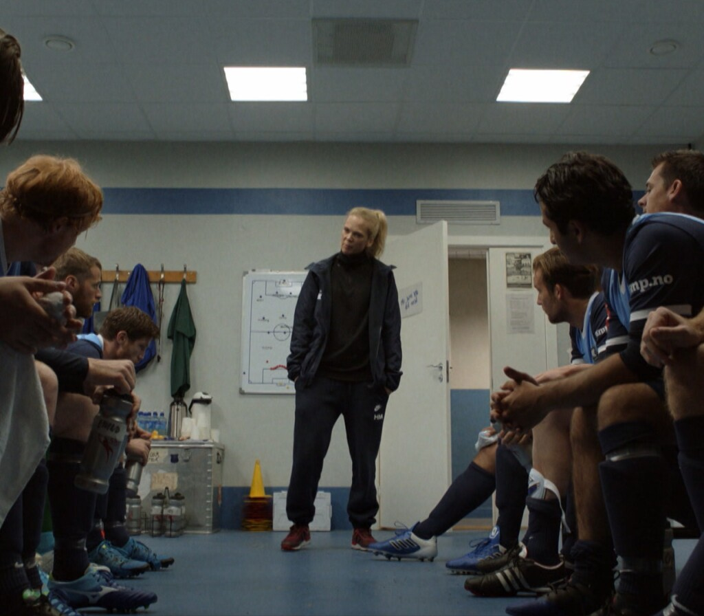 """Helena speaks to her players in the locker room. 