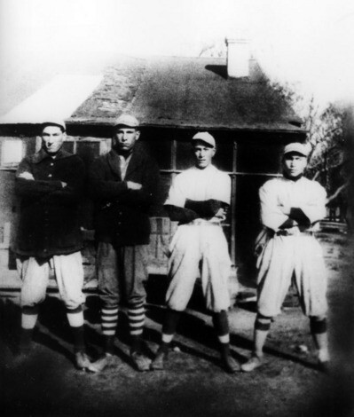 Cecil, second from left, and his brothers dressed to play baseball in Irwindale in the 1920's | Shades of L.A. Collection, Los Angeles Public Library