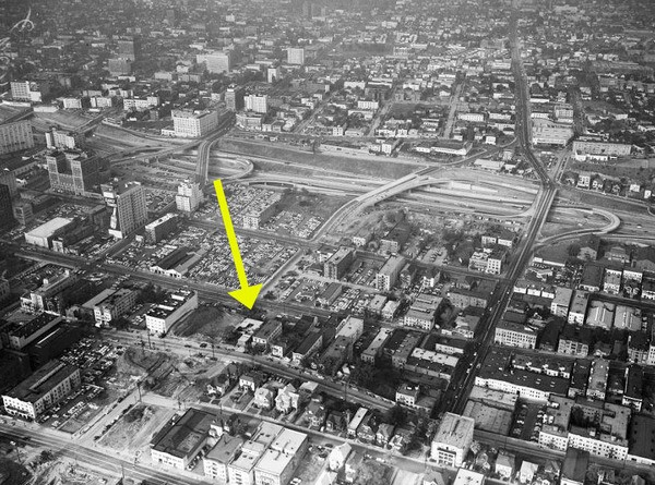 An aerial view of Bunker Hill in 1955. A yellow arrow points to Oliver's house. Courtesy of the USC Libraries - Los Angeles Examiner Collection.