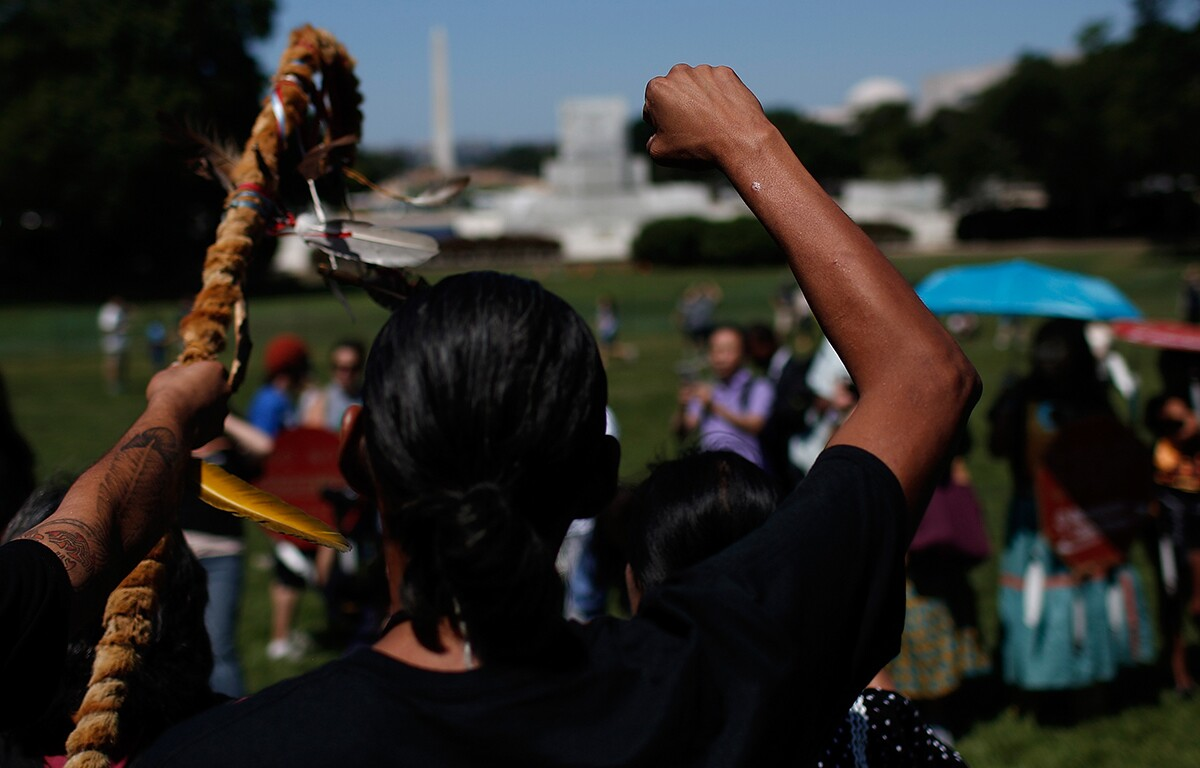 """Members of the the San Carlos Apache Nation attend a protest outside the U.S. Capitol against a land swap that """"threatens the sacred Apache Leap site with environmental damage from nearby high-risk copper."""" July 22, 2015. 