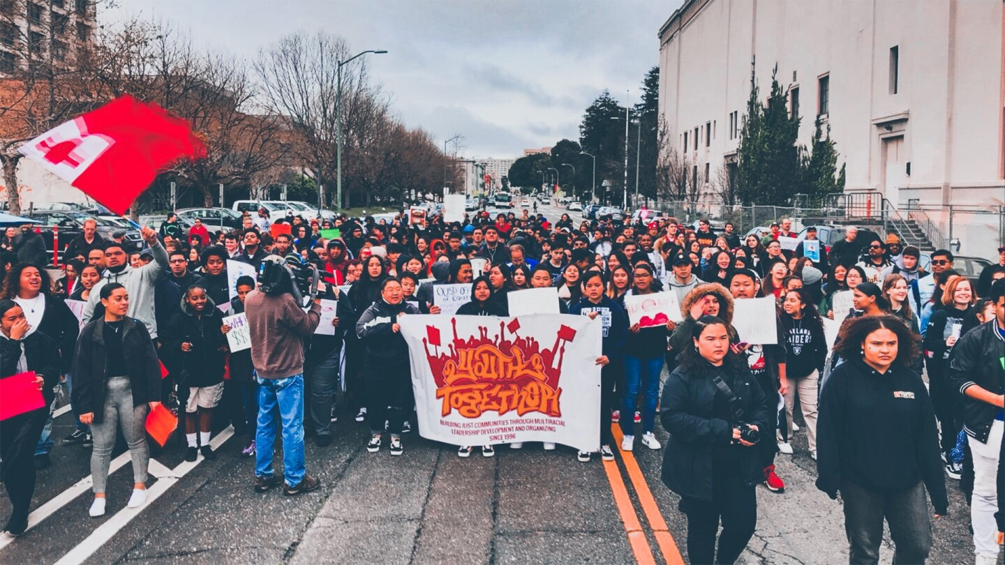 Over 400 high school students walked in unity to the OUSD school board meeting the morning of Monday, March 4th, 2019 following the contract agreement between the teachers union and school district. | Courtesy of Youth Together
