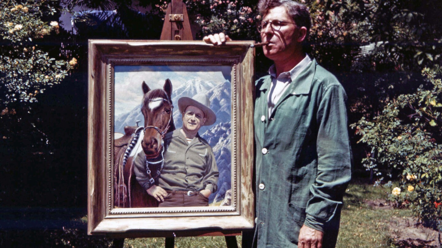 Paul Grimm stands on the side of his painting of Harry Bennett and his horse Sonny.