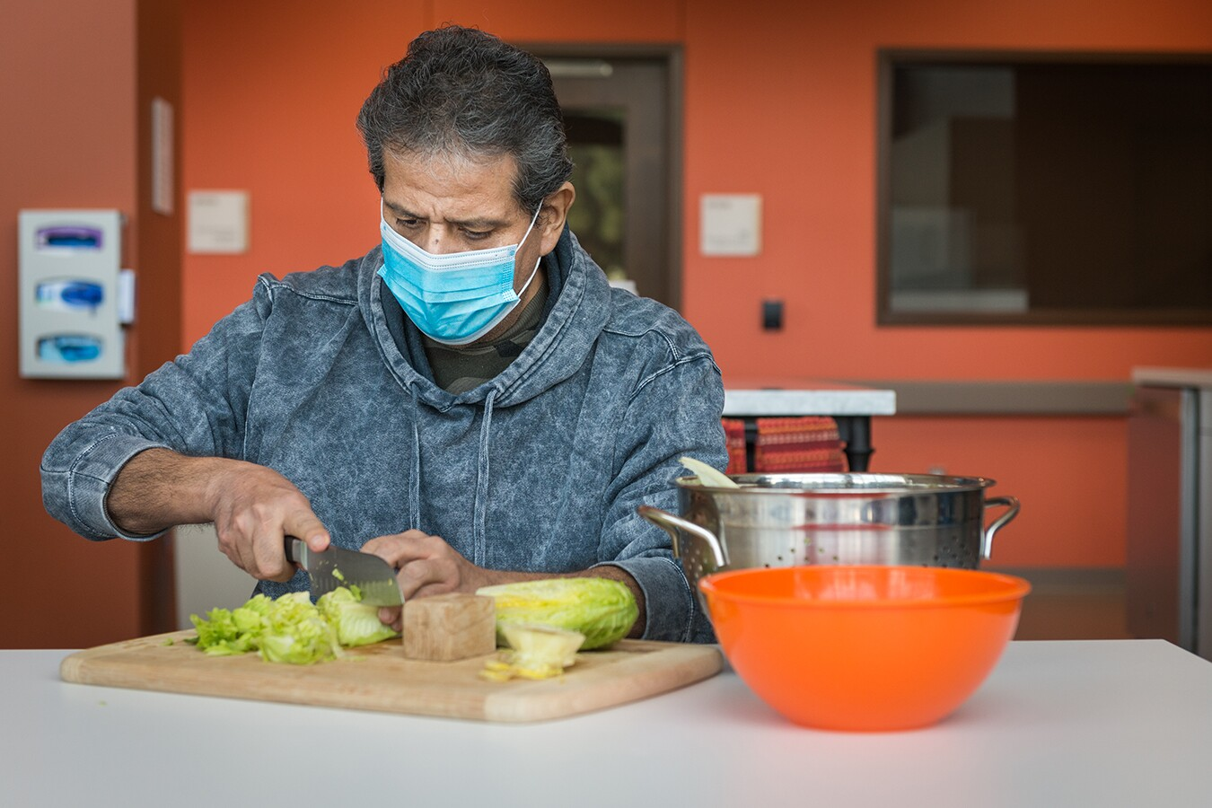 Perez was a cook at a hotel restaurant before he fell ill, so his occupational therapy involves meal preparation.