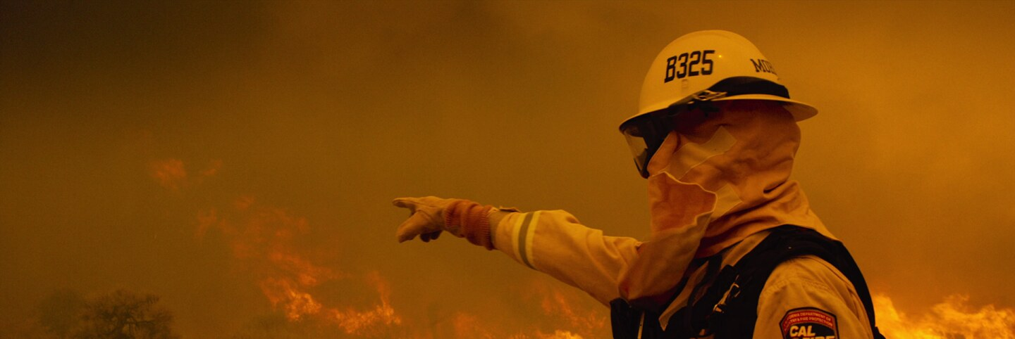 Fire Fighter Pointing at Fire