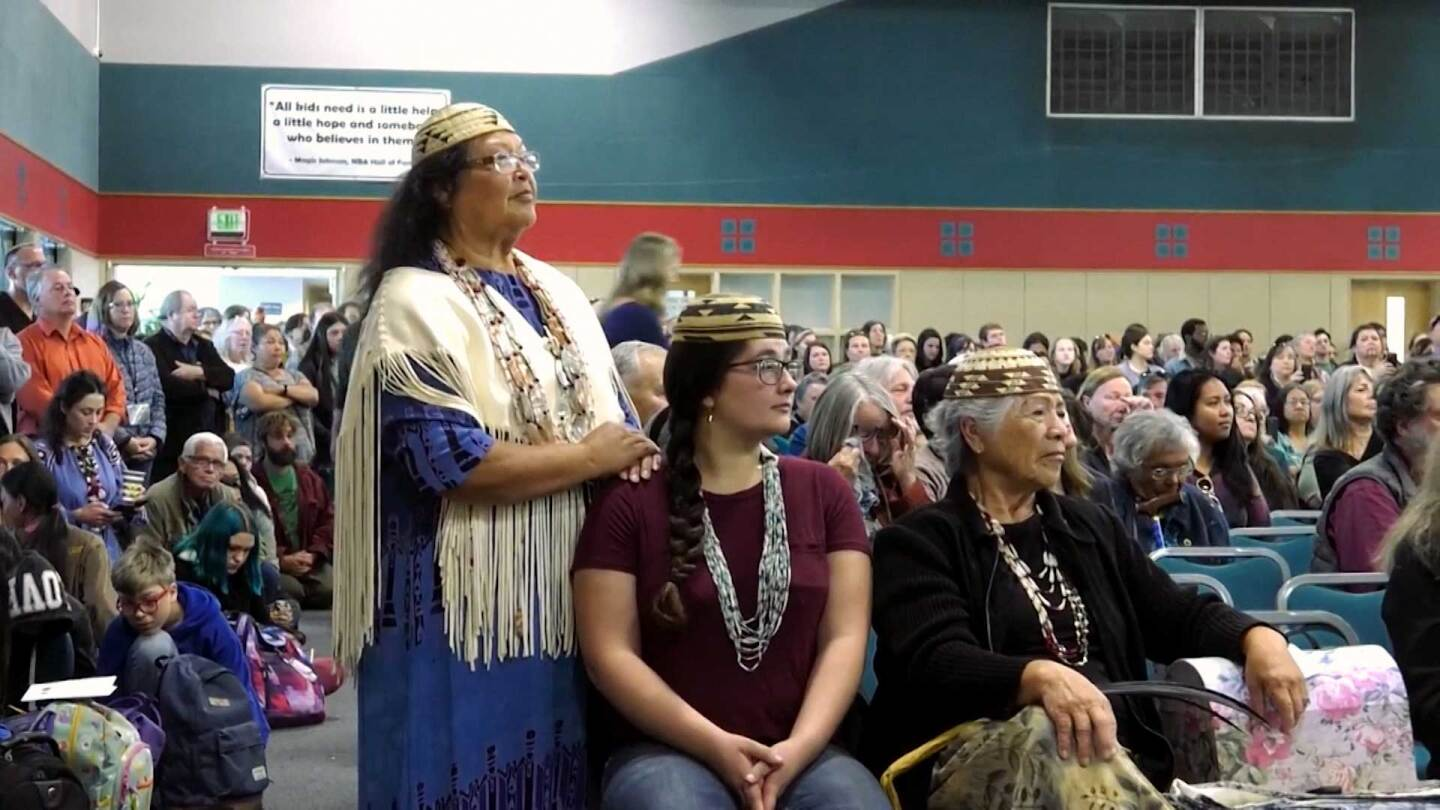 "Cheryl Seidner and other members of the Wiyot tribe at a hearing for Terra-Gen's wind farm proposal. | Still from ""Tending Nature"" episode ""Guarding Ancestral Grounds with the Wiyot"""
