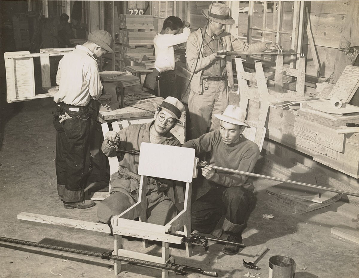 Furniture being made at Heart Mountain Relocation Center for schools, public buildings and administrative offices. | Tom Parker, courtesy of Japanese American National Museum (Identifier 2015.100.250a) ABs10 MMD