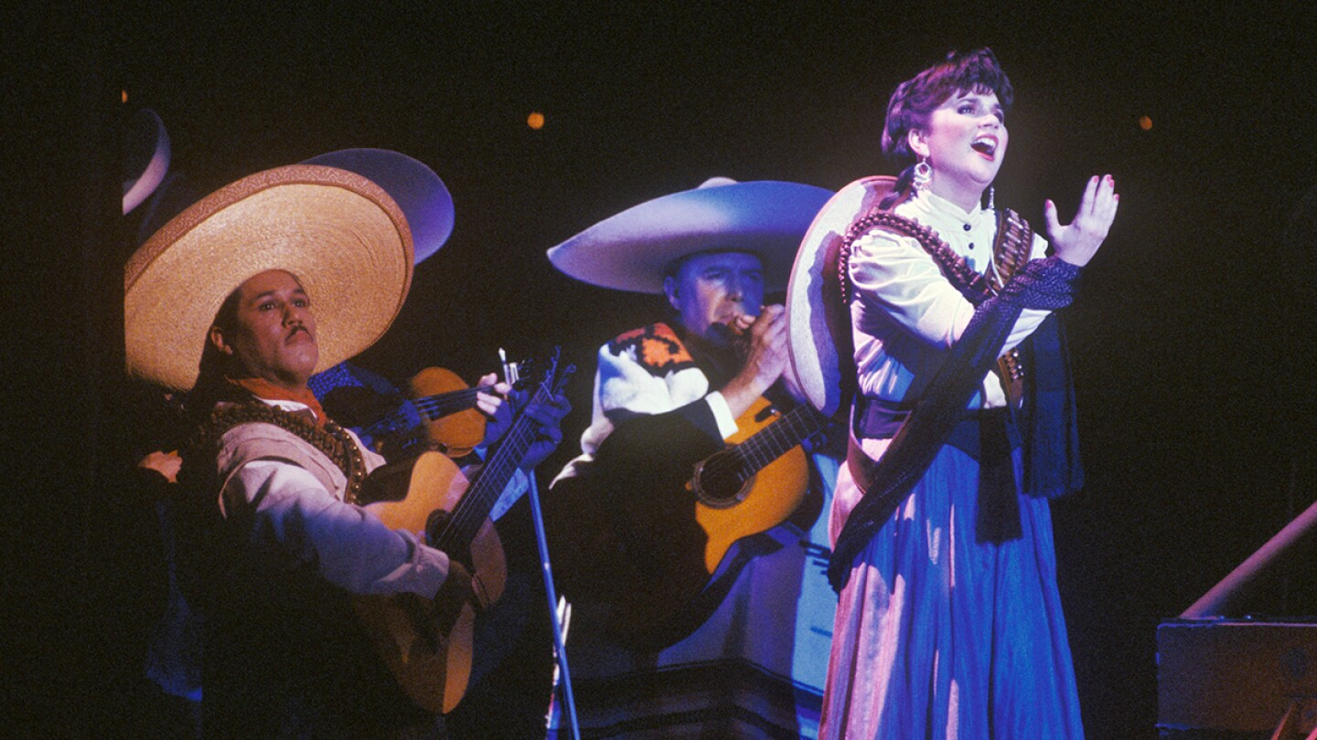 """Singer Linda Ronstadt belts out songs in Spanish from her """"Canciones de Mi Padre"""" album at a 1988 Los Angeles, California concert. 