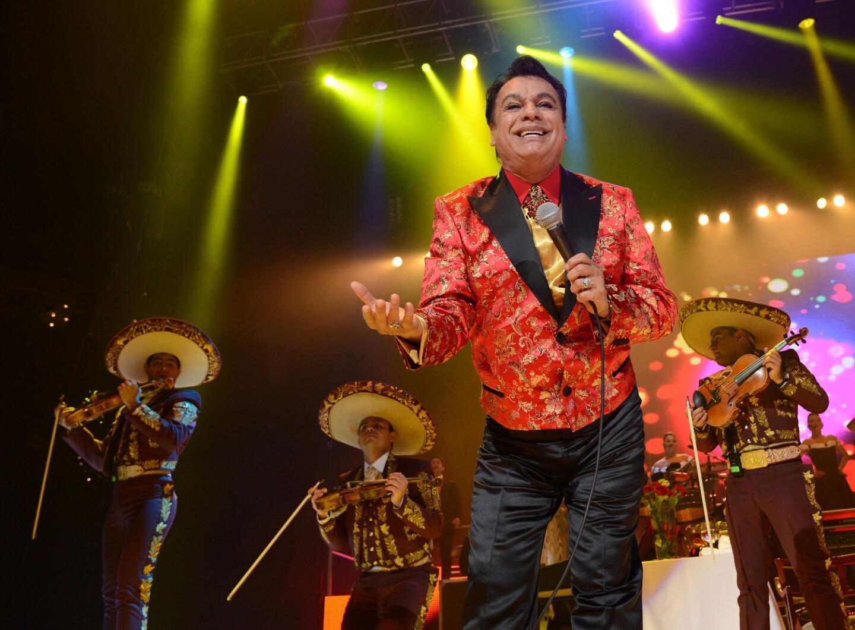 "Singer Juan Gabriel performs during his ""Volver Tour 2014"" in Oakland"