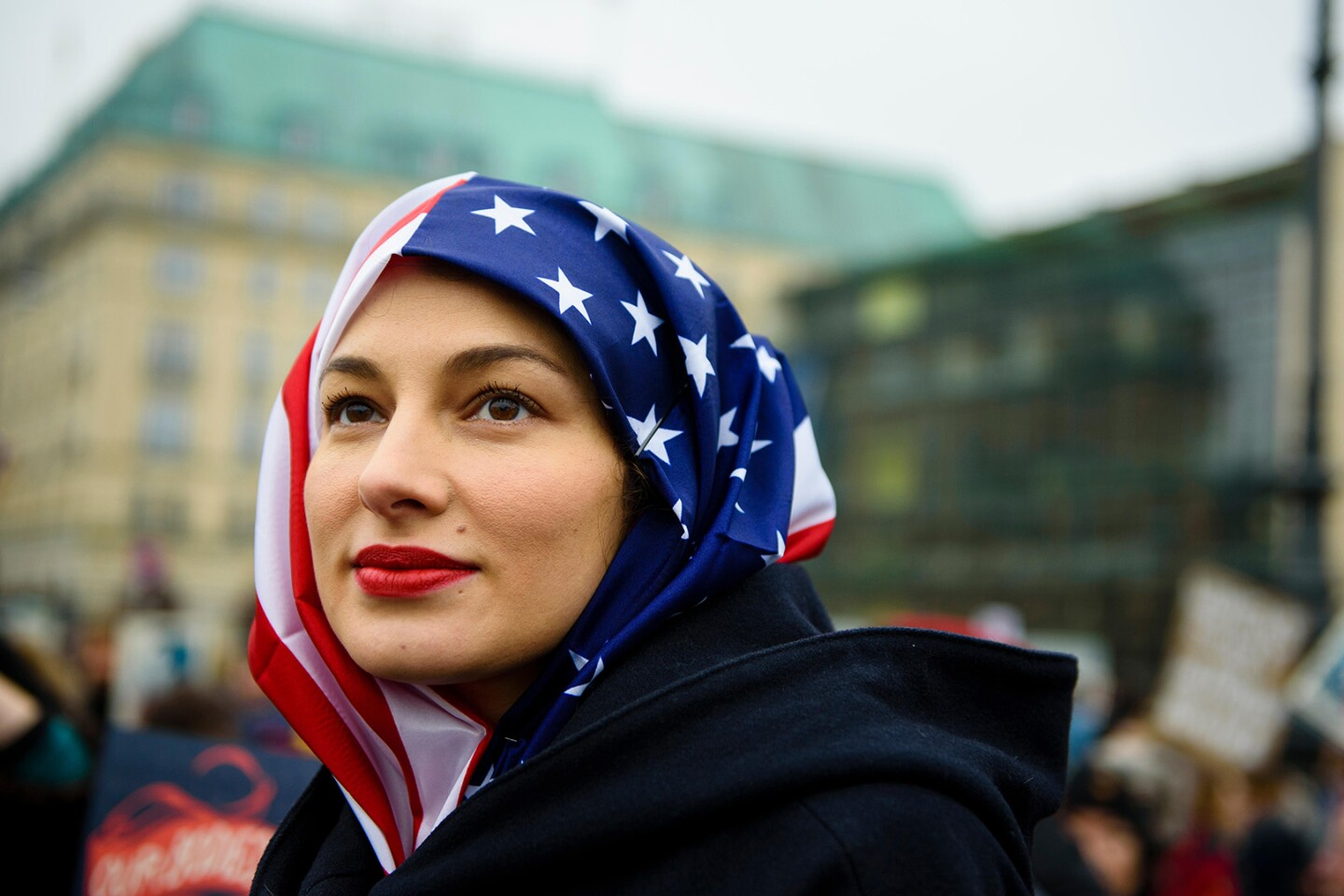 A woman wears a US flag like a hijab
