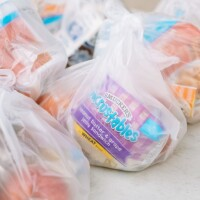 Breakfast packs with a peanut butter and jelly sandwich, cereal, fruit and milk. | Chava Sanchez/LAist