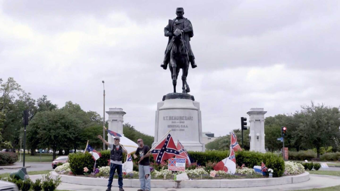 Protestors holding confederate flags in front of the General Beauregard Equestrian Statue, honoring P. G. T. Beauregard, in New Orleans, Louisiana. | Reel South
