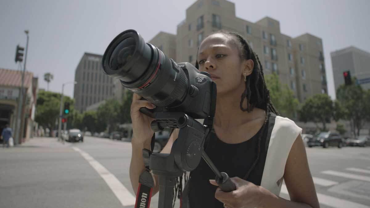 "Janna Ireland taking a photo of a Paul R. Williams work | Still from ""Lost LA"" Paul R. Williams"