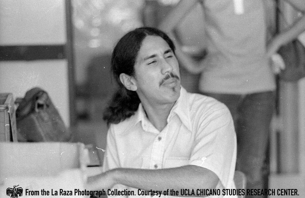 CSRC_LaRaza_B14F6S1_N030 Gilbert Lopez works inside the La Raza magazine office   Patricia Borjon, La Raza photograph collection. Courtesy of UCLA Chicano Studies Research Center