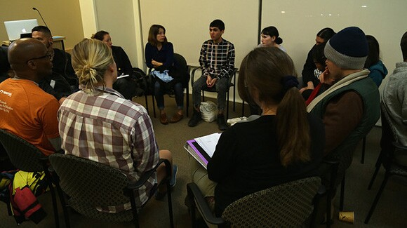 Individuals in dialogue between presentations during Flowers For Action, Seeds For Change event at CalState University Los Angeles, part of Chats About Change event 1/15/15. | Photo: Emily Lacy.