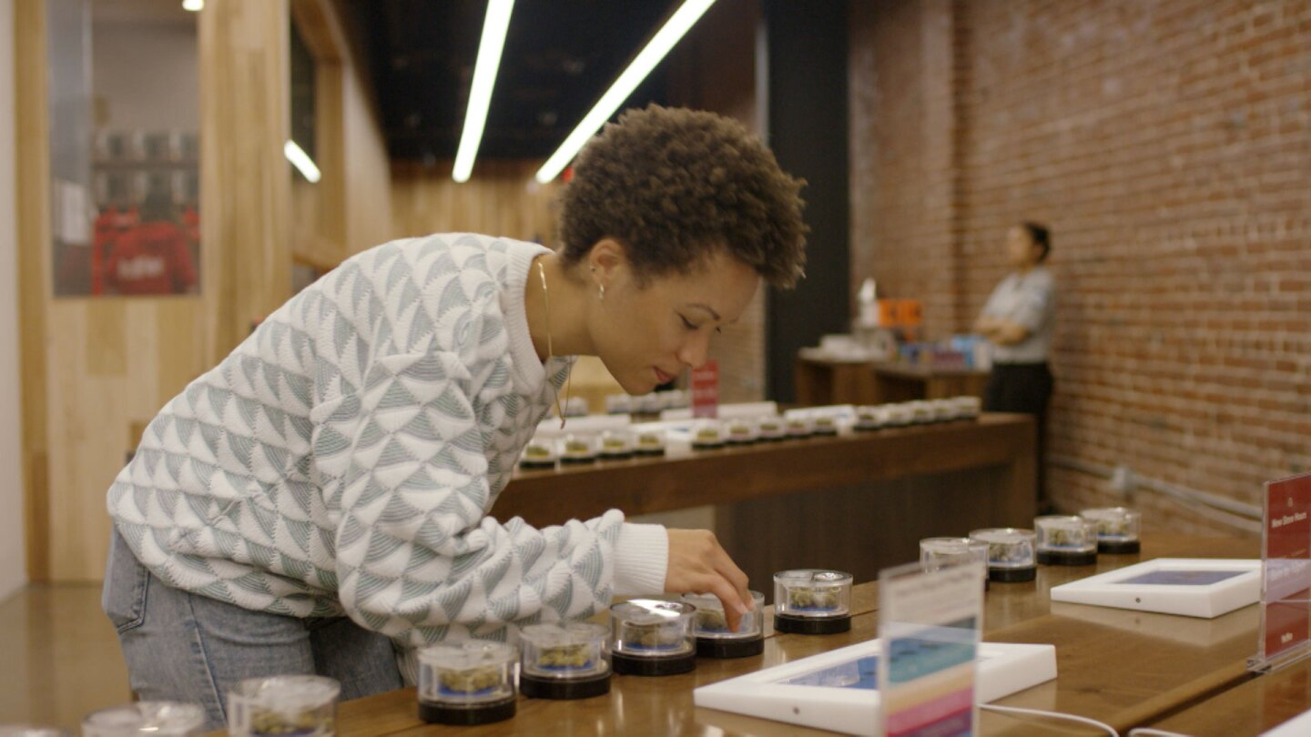 "Customer at browses through cannabis samples at Med Men. | Still from ""Broken Bread"