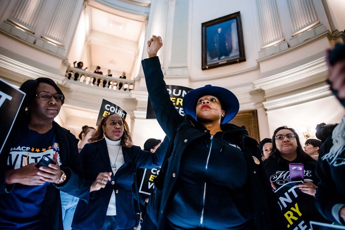 Mary Hooks of Southerners on New Ground leads the Count Every Vote protest at the Georgia State Capitol in Atlanta, Georgia, in 2018. | Kevin Lowery
