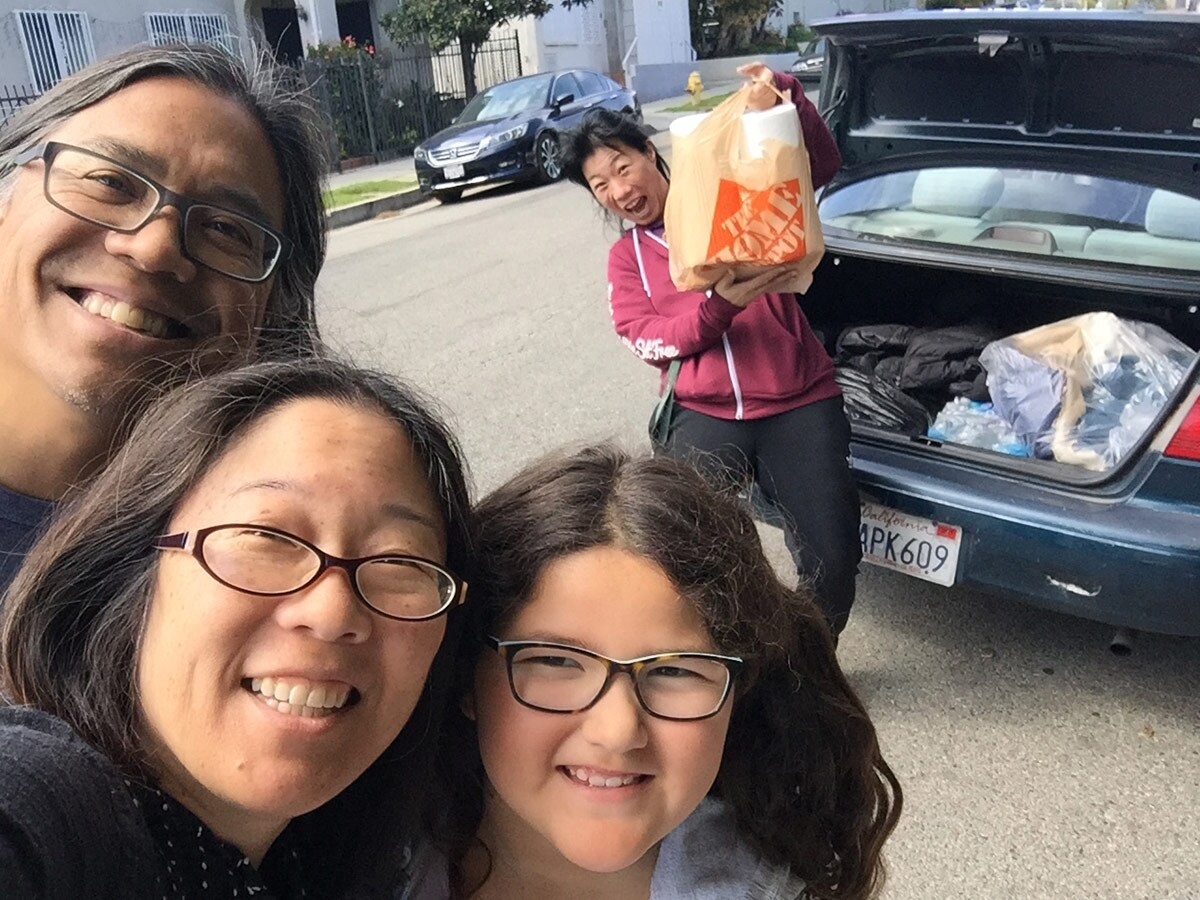 "In the very beginning, Gayle Isa and family pick up their first batch of fabric to cut from friend turned Auntie ""Overlord"" Kristina Wong. 