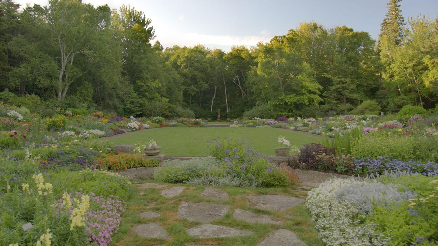 "A garden landscape including a stone path and many different colored flowers. | ""Beatrix Farrand's American Landscapes"""