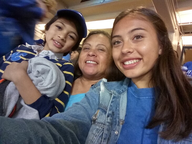 Rina Chavarria, center, with her 12-year-old son and 20-year-old daughter. Chavarria contracted COVID-19 in late April. Co-workers and neighbors have gotten sick, too. | Courtesy Rina Chavarria/UFCW770