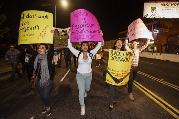 Latino demonstrators show support for activists in Ferguson, Missouri. November 24, 2014 in Los Angeles, Calfornia. Photo By: RINGO CHIU/AFP/Getty Images