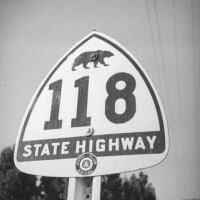 The shield's original 1934 design featured the silhouette of a grizzly bear, present on the state flag but extinct in California since 1922. Photo by Herman Schultheis, courtesy of the Photo Collection - Los Angeles Public Library.