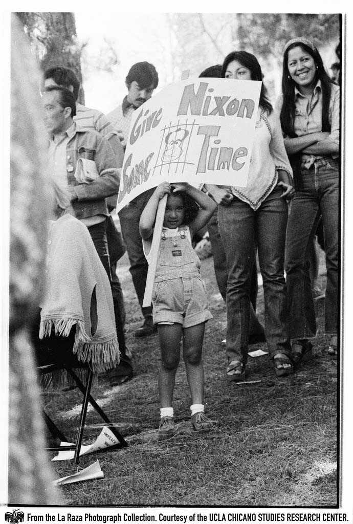 """CSRC_LaRaza_B15F14C1_Staff_016 Girl holds """"Give Nixon Some Time"""" sign at  """"Dump Nixon"""" march from Echo Park to MacArthur Park 