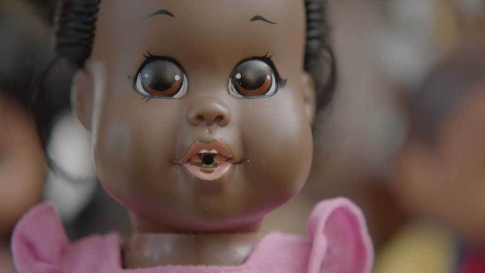 "The Baby Nancy doll produced by Shindana Toys. This doll is now in Billie Green's collection. | Still from ""Lost LA"" Shindana Toys"