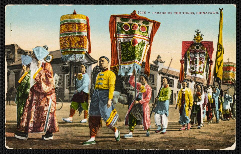 A color postcard depicts a parade in Los Angeles' Chinatown in 1910