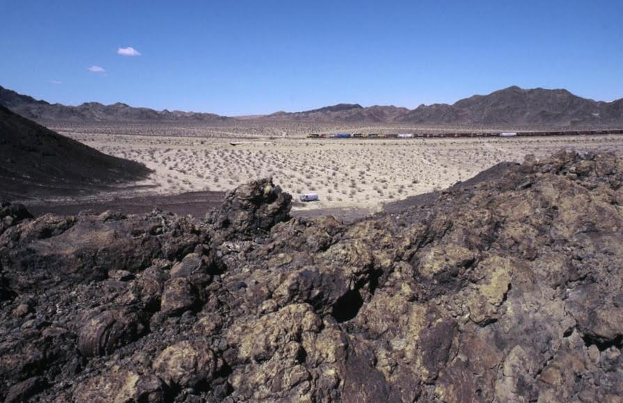 A wide angle view from atop our crater rim in the morning, with the van in the center of the photo.| Richard Steinheimer