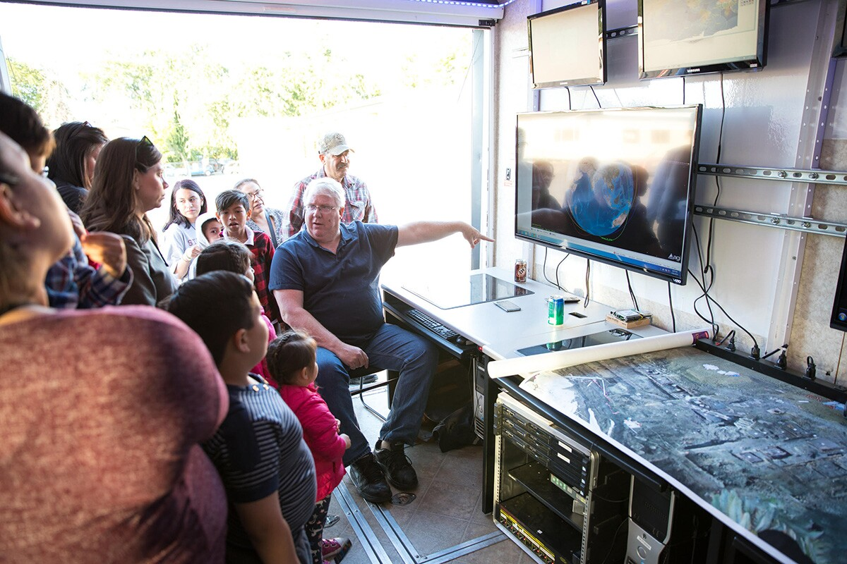 Christopher Kitts in the mobile mission control center during a recent outreach event. | Courtesy of R. Mike Rasay