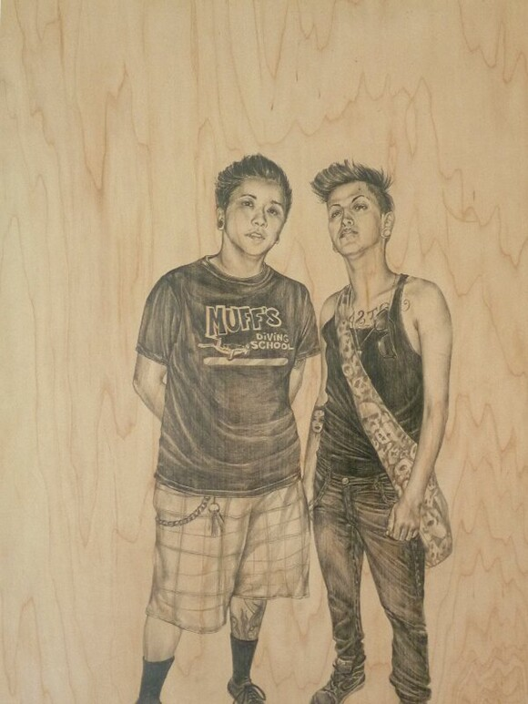 Two people, Cristina and Felix, are drawn on wood.