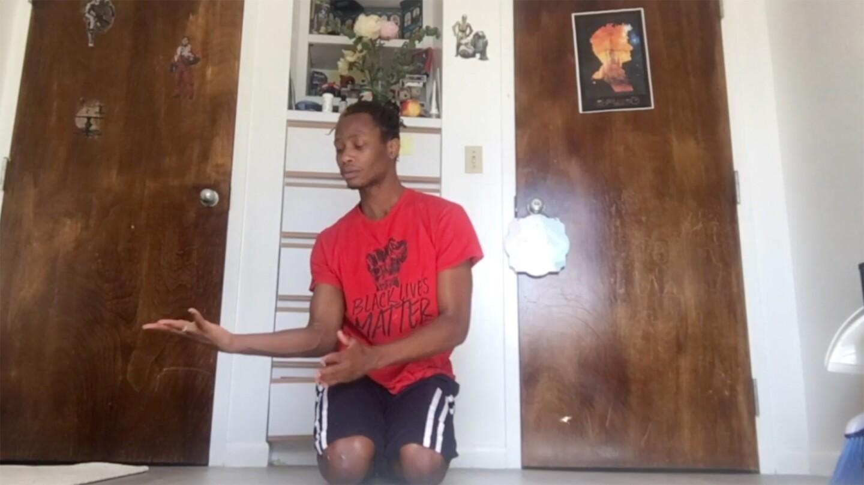 A young man in a red shirt performing a dance on Black Lives Matter, one of Invertigo's Dance Care Package performances | Courtesy of Invertigo
