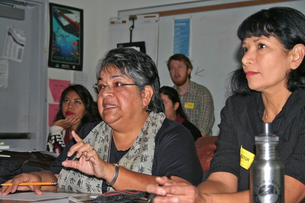 Ceci Dominguez offers advice to the students as Ruth Gallardo listens