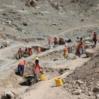 Labourers on the hills of Bagrami, on the outskirts of Kabul, dig trenches to help improve the city's water supply, Kabul, Afghanistan, June 6, 2020. | Thomson Reuters Foundation/Shadi Khan Saif