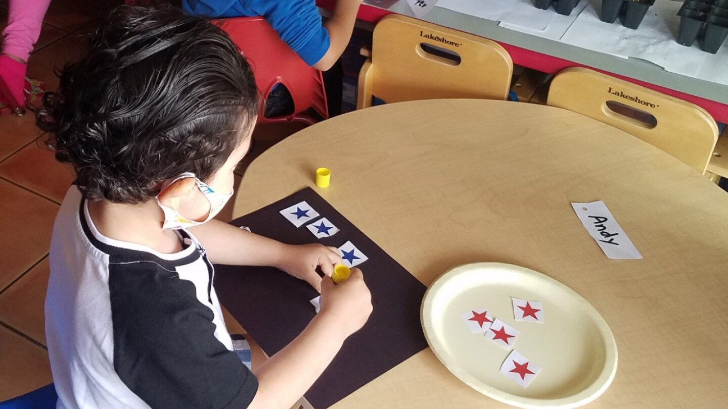A small child sorts stars at a day care that took part in a pilot hybrid program from PBS SoCal focused on early science and math.