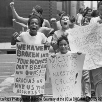 CSRC_LaRaza_B15F2C1_DZ_016 Protesters in la Marcha por los Tres in front of L.A. City Hall | Daniel Zapata, La Raza photograph collection. Courtesy of UCLA Chicano Studies Research Center