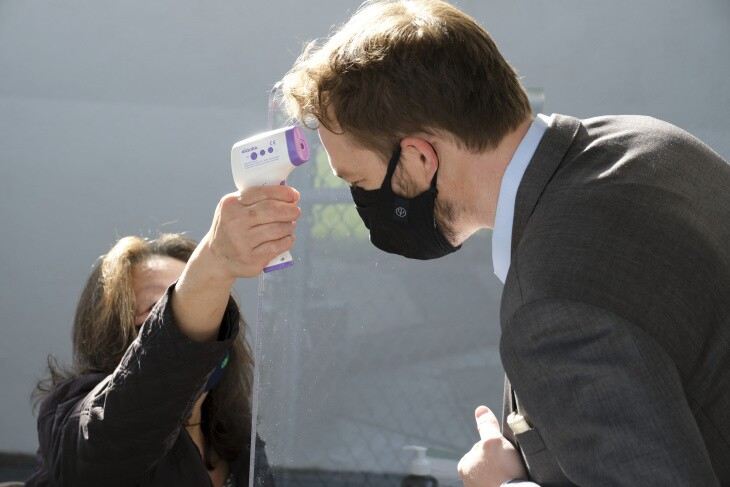 L.A. Unified School Board member Nick Melvoin has his temperature checked before a campus tour at Walgrove Avenue Elementary School on March 17, 2021.