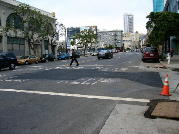 Street cuts, seen here in San Francisco, can often be identified as square or rectangular excavations made by workers to access below city streets