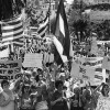 Protesters send Castro a message: 'Let my people go', 1980 photo by Dean Musgrove. | Los Angeles Public Library Herald-Examiner Collection