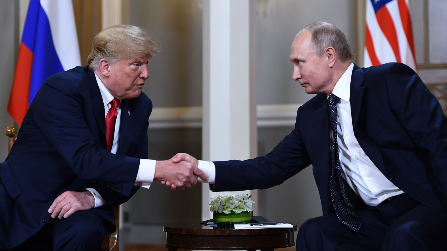 U.S. President Donald Trump (left) and Russian President Vladimir Putin (right) shake hands before a meeting in Helsinki, on July 16, 2018.    BRENDAN SMIALOWSKI/AFP/Getty Images)