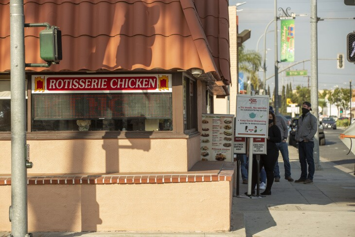 Customers wait in line at King Taco in Maywood. | Chava Sanchez/LAist