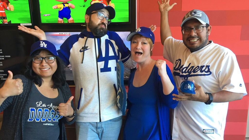 Employees of PBS and KCET celebrating Dodgers opening day