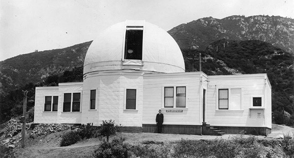 Observatory director Dr. Edward Larkin stands outside of the early wooden structure of the Mount Lowe Observatory at Echo Mountain in the San Gabriel Mountains. | Courtesy of the Los Angeles Public Library