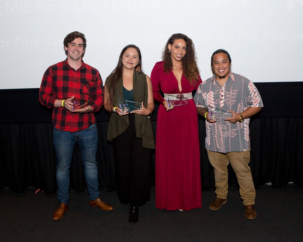 L-R UCLA student William Rowe, Chapman University's Erin Lau, University of Southern California (USC) film school student Kelley Kali and USC's Shaun Dikilato accept their finalist awards at KCET's FINE CUT Festival of Films at the Landmark Theatre.