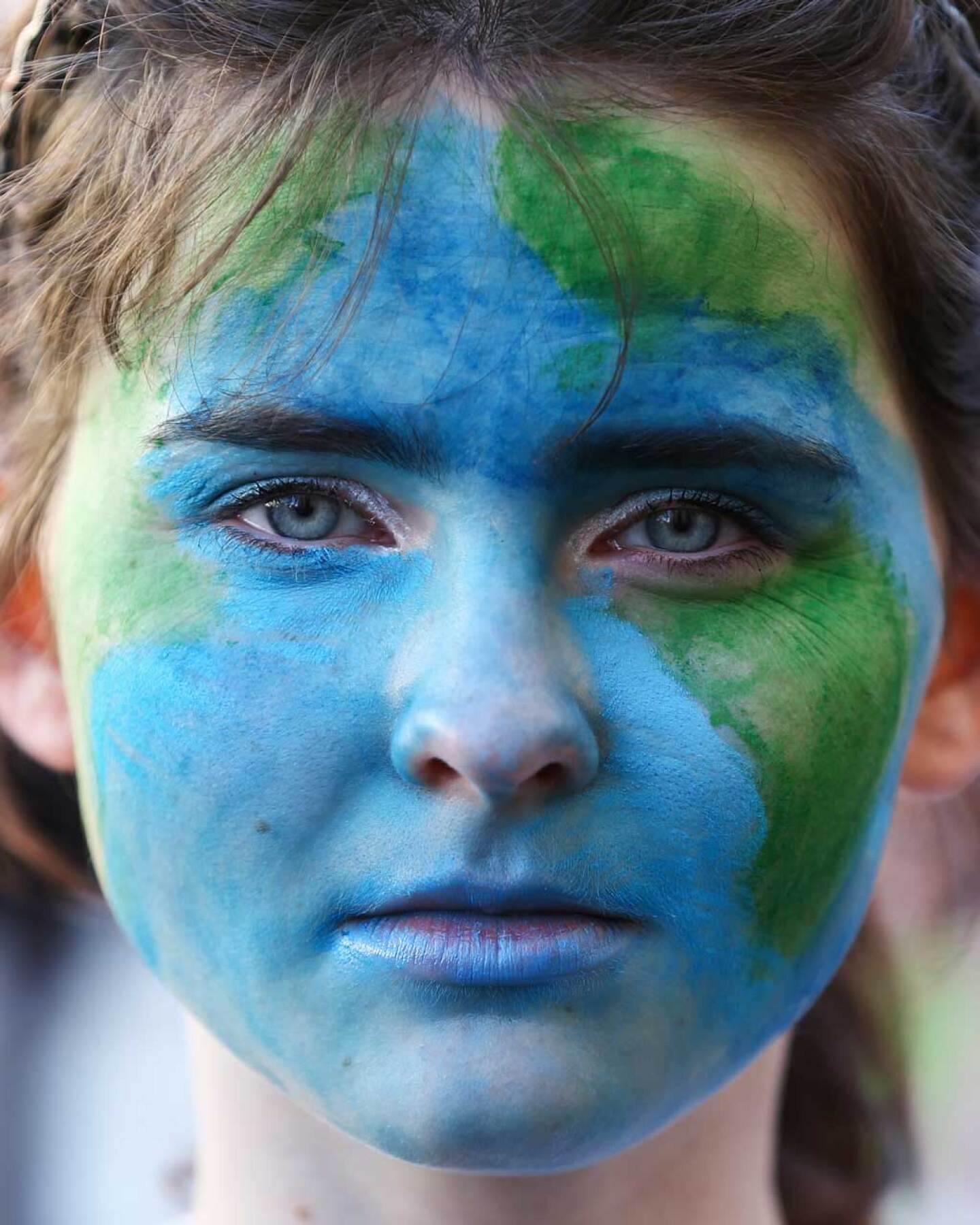 A protestor in New Zealand looks on during a strike to raise climate change awareness in September 2019. | Hagen Hopkins/Getty Images
